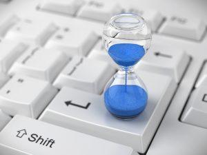 Hourglass on computer keyboard